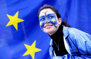 "This girl protests in Brussels against removing the Flag and Anthem from the European Constitution. ""Pro Euro Demonstration"". By Rock Cohen."